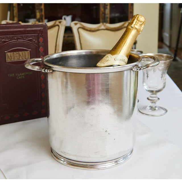 Lovely vintage silver plate champagne/wine bucket from Marc Stevens, Inc., which could have possibly been part of the...