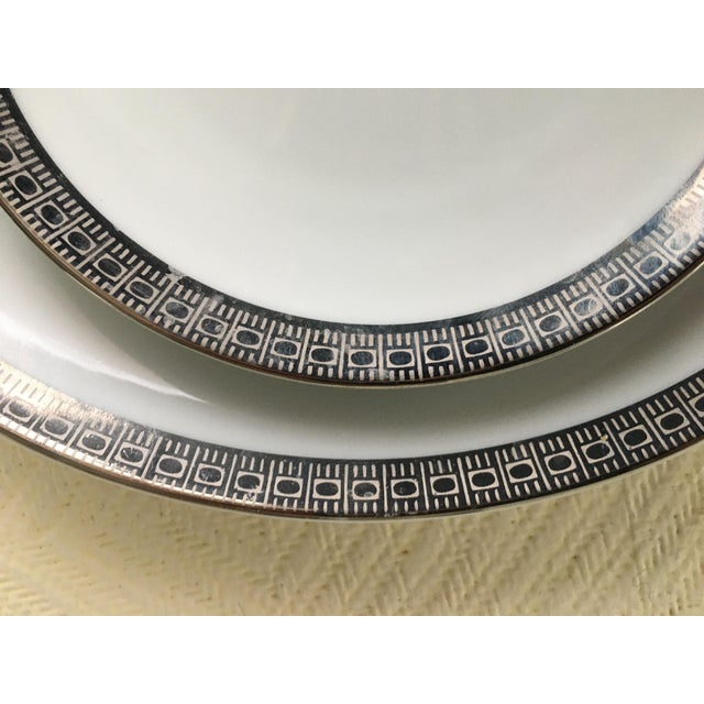 A timeless modern classic, this is a large set of Mikasa dinnerware circa 1960s, featuring a silver-on-silver graphic...