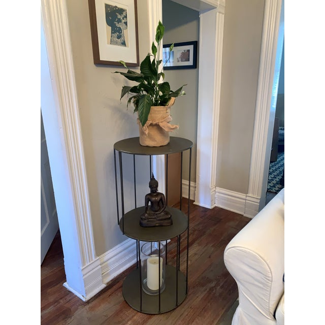 Tall metal round side table stand with three shelves by Kalalou. Great as a plant stand and tall side table. Large shelves...