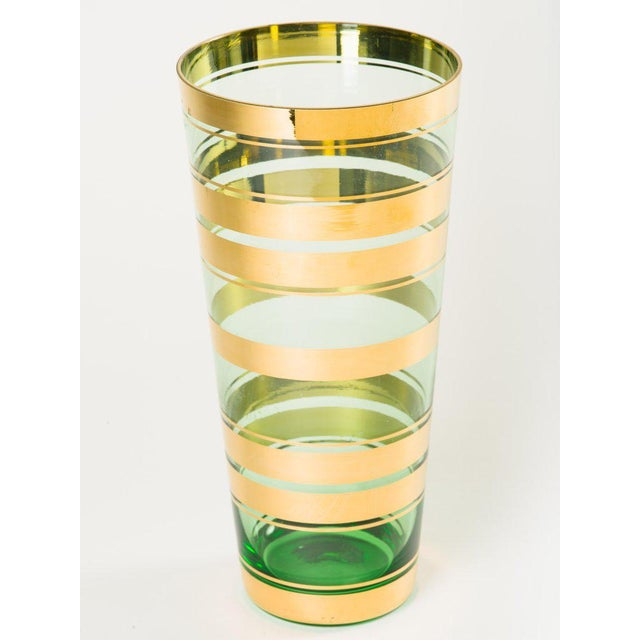 Vintage Czech Republic handblown art glass vase with tapered form. Features beautiful translucent green glass with...
