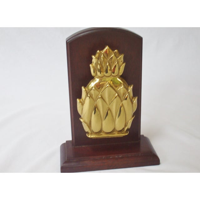 A big brass pineapple knocker made by Newport mounted on oak wood. This piece can be removed from the wood and used as a...