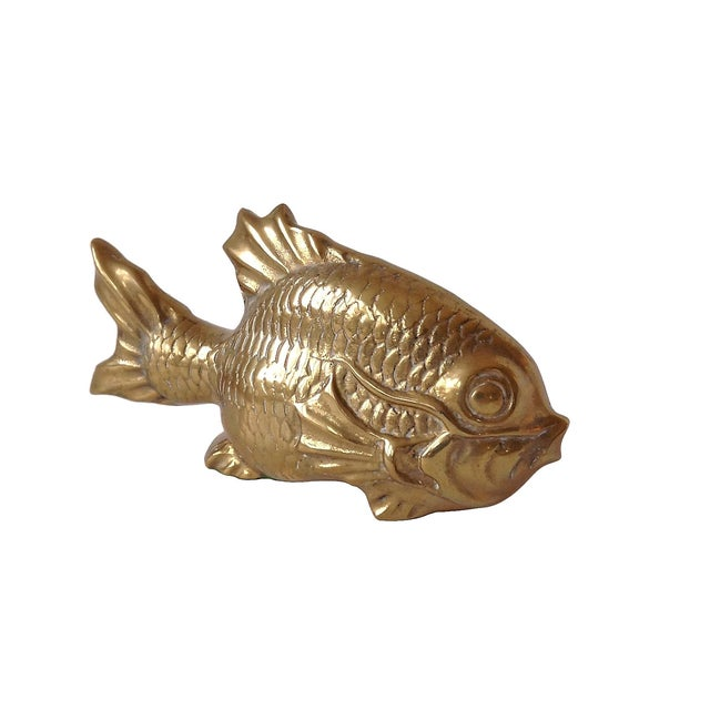 Offered is a large vintage brass koi fish figurine. This piece is wonderful for styling bookshelves or tablescapes. Light...