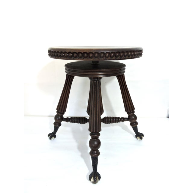 Classic Piano Stool made by Tonk & Co, New York & Chicago. The round seat has beaded edging detail with ball and claw iron...