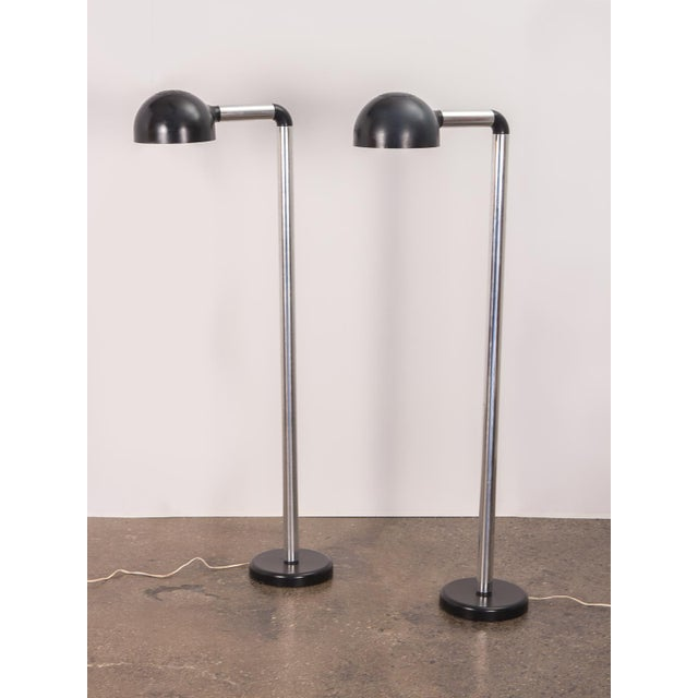 Pair of futuristic Robert Haussmann Chrome Floor Lamps for Swisslamps. These mid-sized, post-modern floor lamps are highly...