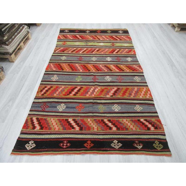 Handwoven vintage embroidered kilim rug from Denizli region of Turkey. In very good condition. Approximately 45-55 years old.