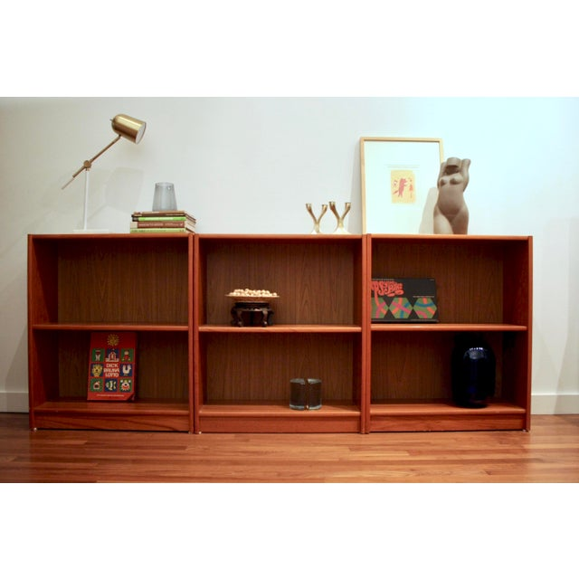 fantastically simple trio of teak bookcases that can be placed side by side for a long - Teak Bookshelves