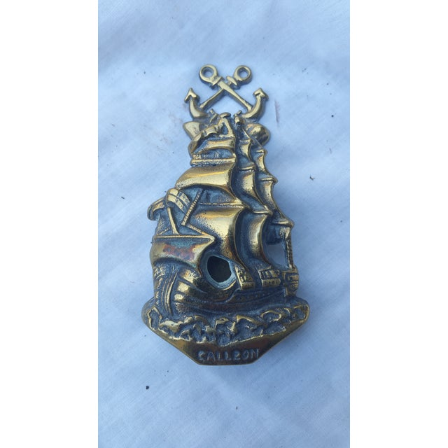 An antique English door knocker in the form of a galleon. England