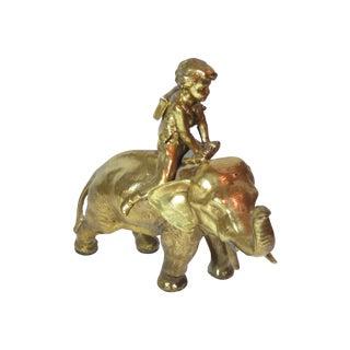 Boy Riding Elephant Figurine For Sale