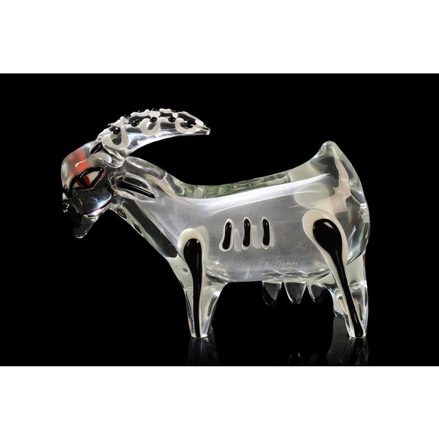 Large sculpture of a goat made of thick transparent glass with applications of lattimo, black and red glass and slight...