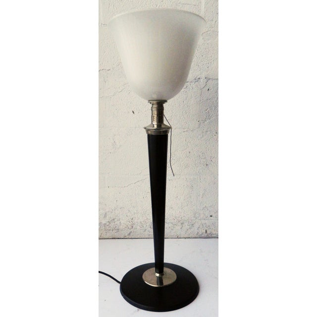 This 1930s, French table torchiere light by Mazda features a black lacquer and chrome base and a white opaline shade glass...