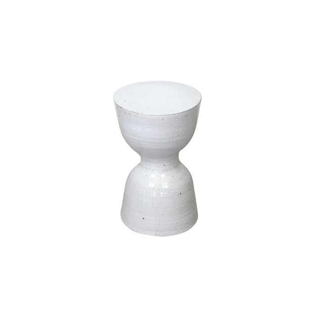 Larger scaled white glazed hourglass ceramic stool or table by Tariki Studio. This piece features a delicate textural...