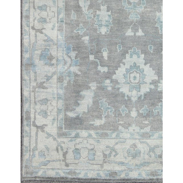 Keivan Woven Arts, Ob-103433730, Vintage Gray Oushak Rug- 8′6″ × 11′6″. This hand-knotted vintage grey and blue Oushak rug...