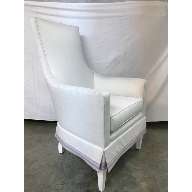 The Charlottesville Wing Chair is a first quality market sample that features a Springdown Medium Seat Cushion and a Kick...