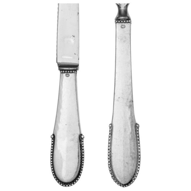 A danish silver bar set of georg jensen silversmithy, copenhagen. In the beaded pattern, comprising a bottle opener and...