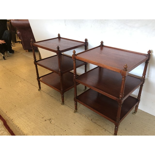 A great looking well-made pair of 3-tier solid mahogany end or side tables having turned legs and finials as well as...