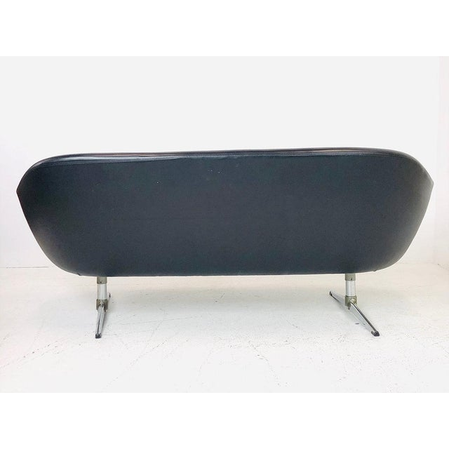 Sculptural MCM black vinyl Overman Pod Sofa. This sofa is light weight durable construction with brushed aluminum legs.