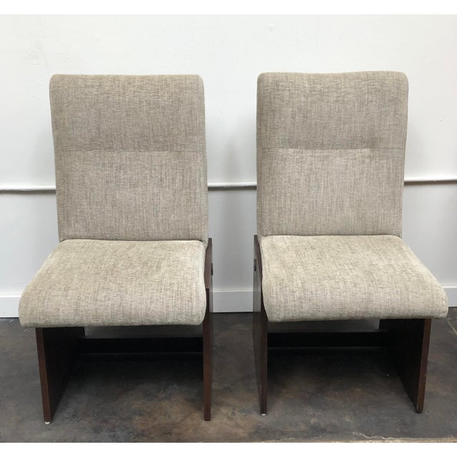 Pair of Lane Mid-Century Modern chairs with a beautiful slanted walnut base enhanced with copper banding. We recently...