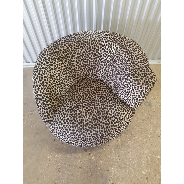 Vladimir Kagan Nautilus swivel from the 80's covered in a cotton Cheetah velvet.