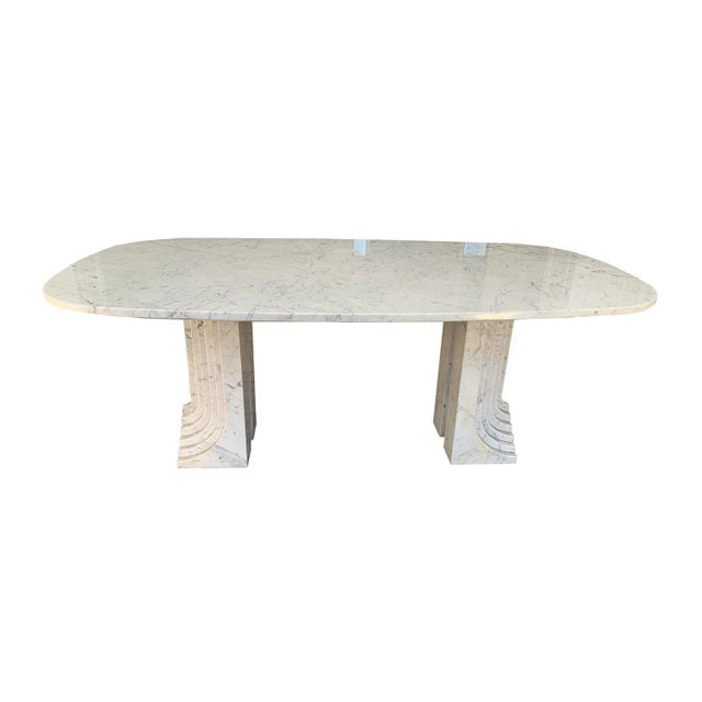Beautiful and rare dining room table attributed to Carlo Scarpa, 1970s. The table is made of a marble top with a shape...