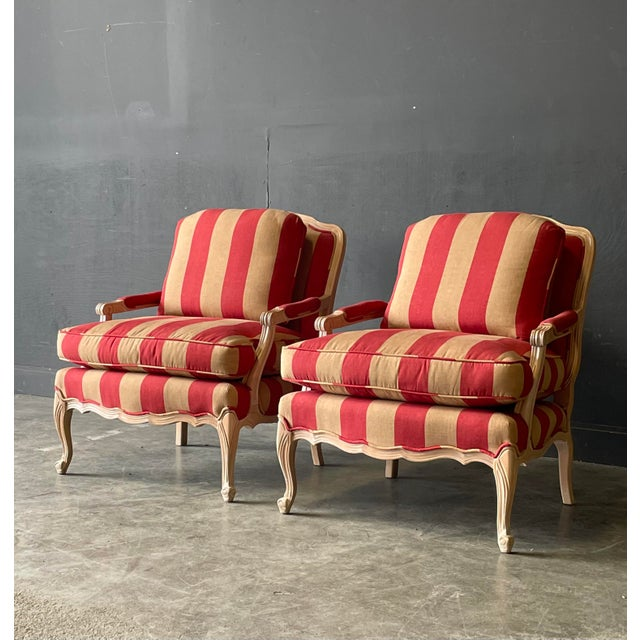 Pair of French country style lounge chairs and ottomans. Beautiful colors pickled pine finish to the wood frame. Ottoman...