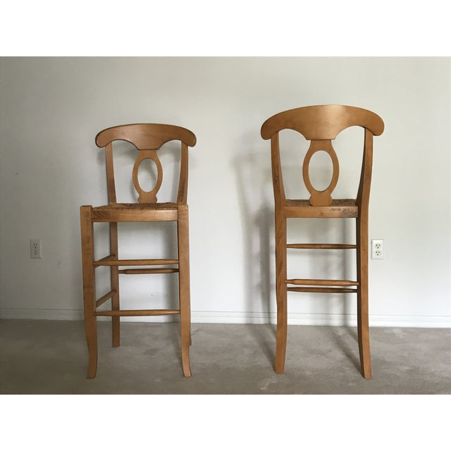 Pottery Barn Napoleon® bar stools. Solid hard wood with natural rush seat. Made in Italy