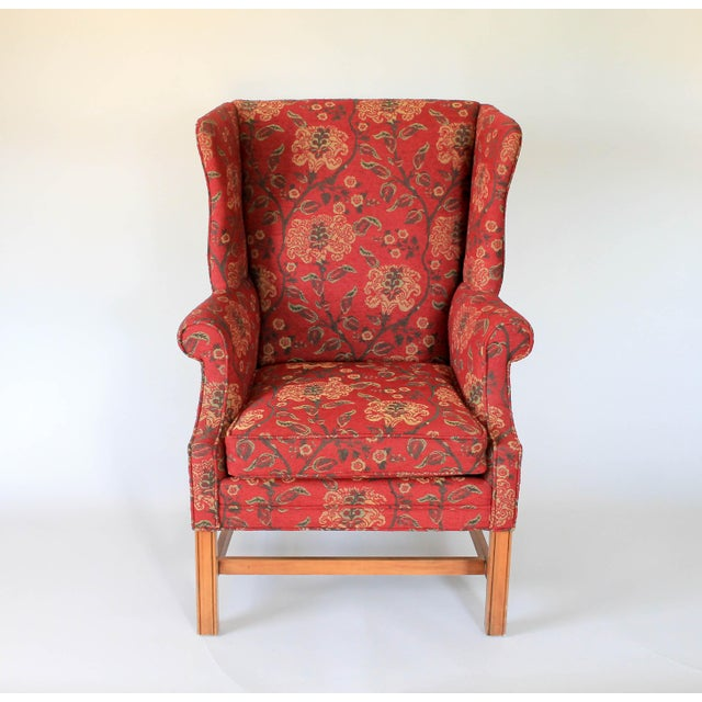 Upholstered wingback chair with Chippendale style legs and matching pillow. Some wear to wood. No makers mark.
