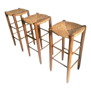 Charlotte Perriand Set of Three Rush Bar Stools, Circa 1950 For Sale