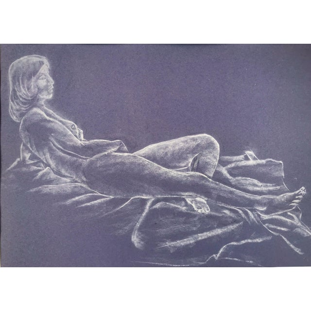 Original white conte crayon figure study of a reclining nude on purple paper. Initialed lower right. Presented matted and...