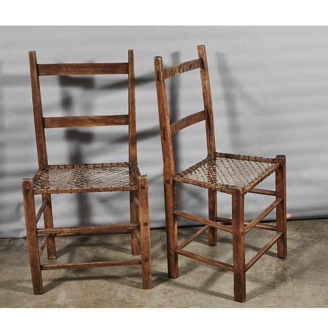 A classic pair of camp chairs with pine frames and woven gut seats. These are sold as is.