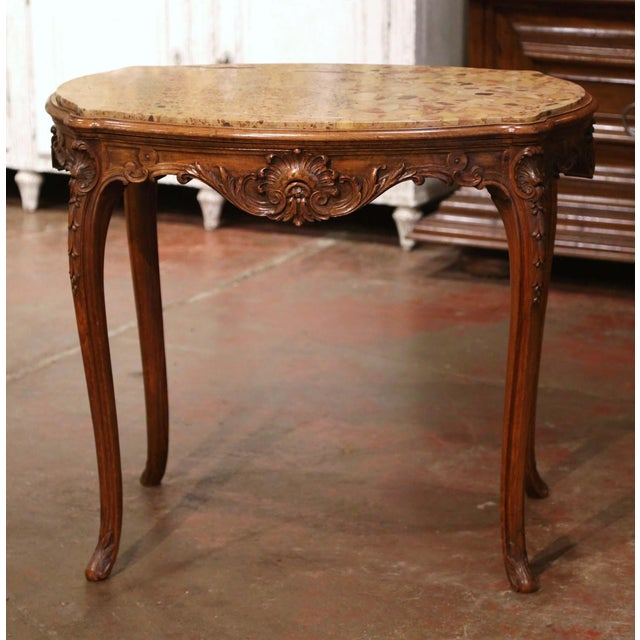 Crafted in France, circa 1880 and oval in shape, the antique table stands on cabriole legs ending with acanthus leaves at...