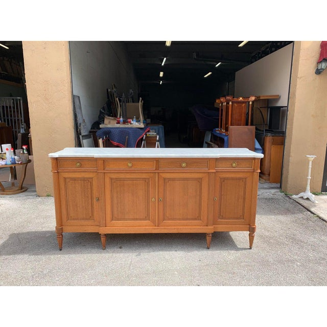 Long French antique Louis XVI style sideboard or buffet made of mahogany with a beautiful Carrara marble top, the mahogany...