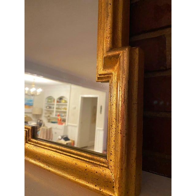 Gorgeous Art Deco gold leafed solid wood framed mirror. Made in the 1930s.