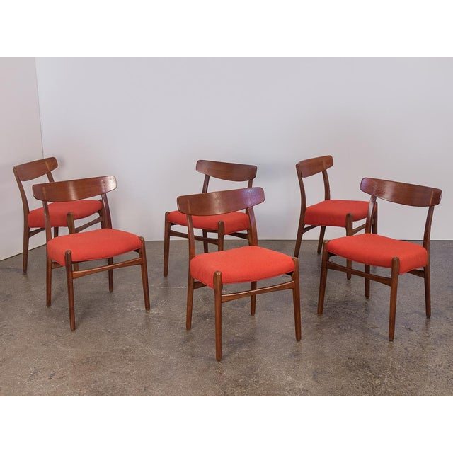 Set of six original Hans J. Wegner Ch-23 Dining Chairs from the 1950s. Deceptively simple at first glance, the chairs are...