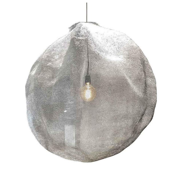 This hand braided pendant light made of stainless steel has been exclusively designed by Mark Eden Schooley for Atmosphere...