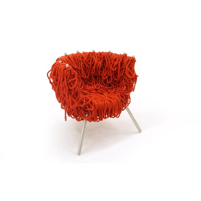 Rare Vermelha chair by Fernando and Humberto Campana for Edra. Red rope covers the powder coated steel and aluminum frame....