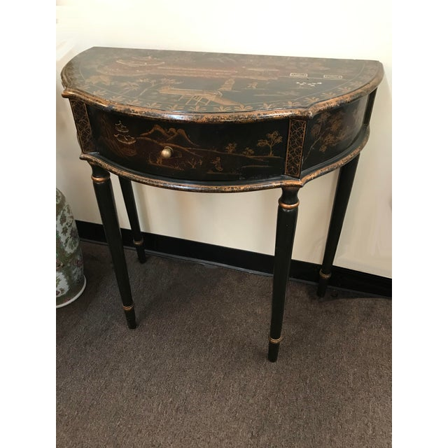 Small 20th century English chinoiserie demi lune table with drawer.