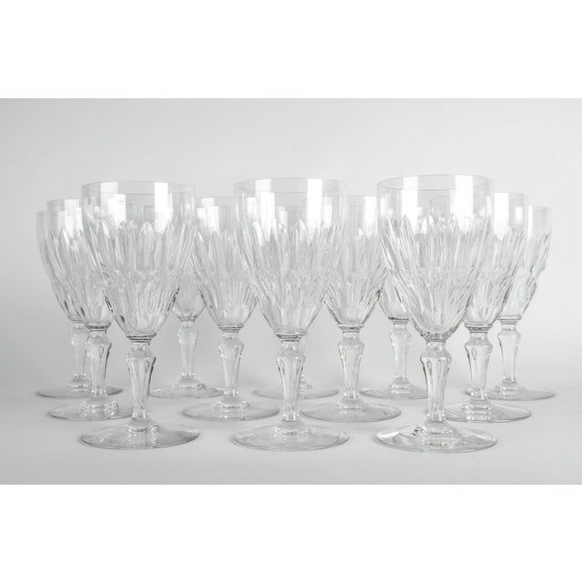 Mid-20th century Baccarat crystal wine / water glassware set of 12 pieces. Each glass is in excellent condition. Each...