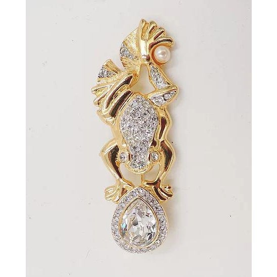 """1980s goldtone pavé rhinestone with big pear shaped rhinestone and faux-pearl frog pin. Marked """"V."""" Excellent condition...."""