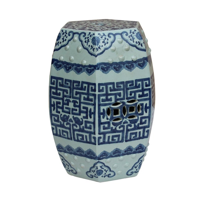 This is an oriental blue & white ( minor off white tone )porcelain stool with nicely handpainted scroll pattern around the...