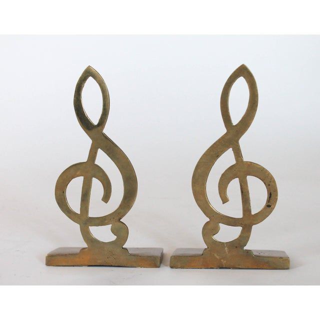 Pair of brass music note bookend in the shape of two treble clef. Made by Penco. Made in Taiwan. Patina.