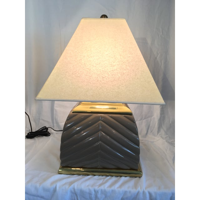Deco style ceramic and brass lamp with vellum shade. 12 x 12 x 24 without the shade.