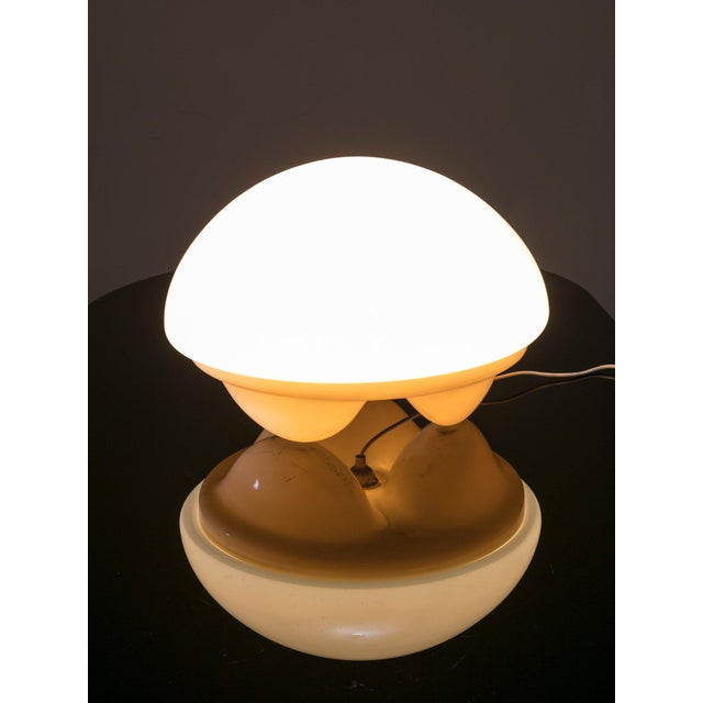"Rare ""Isotta"" table lamp by E. Gentile and manufactured by Sormani. Opaline glass shade and plastic base."