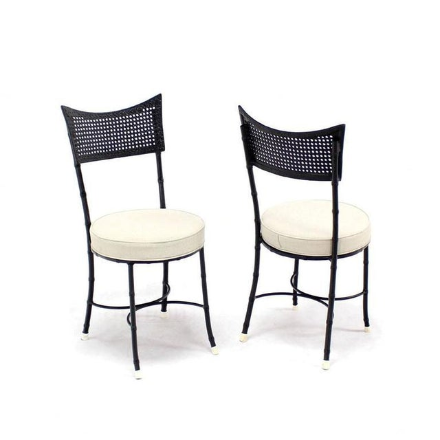 Nice four Mid-Century Modern cast aluminum chairs imitating faux bamboo. With propriate upholstery can be used outdoor....