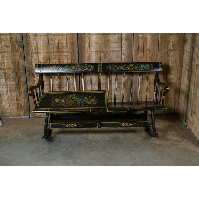 American wooden rocking bench in the Hitchcock Style, circa 1890s. Designed to be a cradle rocker combination to cradle...