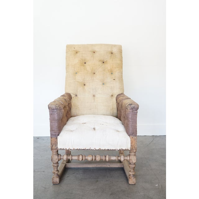 This is an 18th century, French chair in the style of Louis XIV with turned spindle legs and stretcher. Chair is complete...