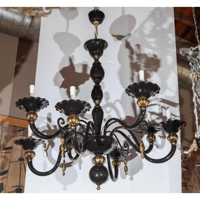 Italian Venetian chandelier with hand blown black Murano glass and gold Murano glass details / Made in Italy circa 1960's...