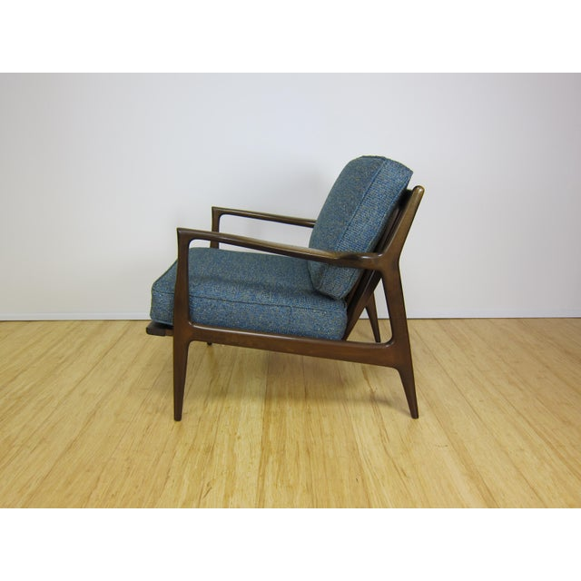 Ib Kofod Larsen Danish lounge chair circa the 1960's for Selig Furniture. Walnut stained frame shows light fading to arm...