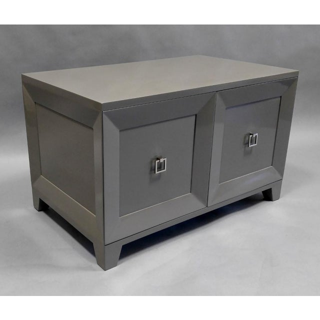 Custom end table / night stand with doors and matching side panels in high gloss painted grey color with polished nickel...