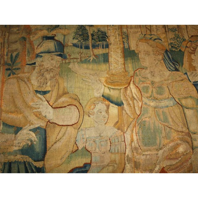 A large 17th century tapestry of soldiers greeting royal ladies outside of a walled city, the soldiers' campaign tents in...
