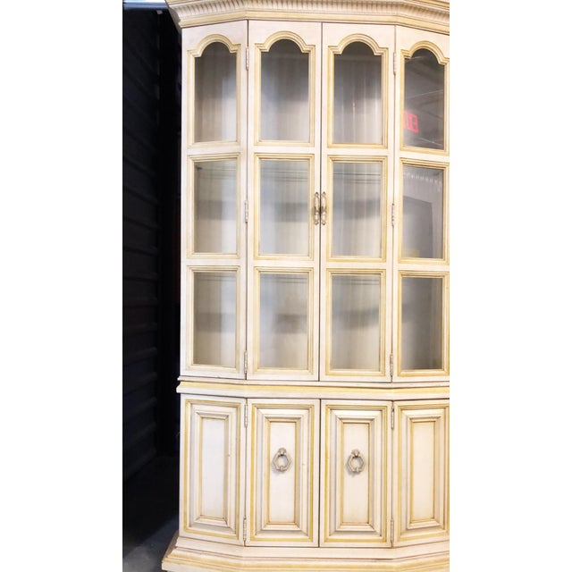 China cabinet in excellent condition, two piece construction with glass doors and sides, glass shelves, cabinet lighting...